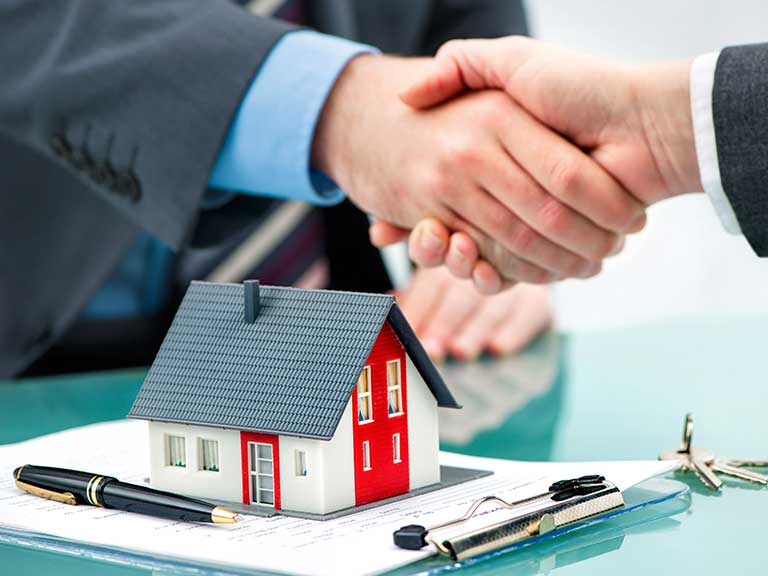 A buy-to-let mortgage is completed with a handshake