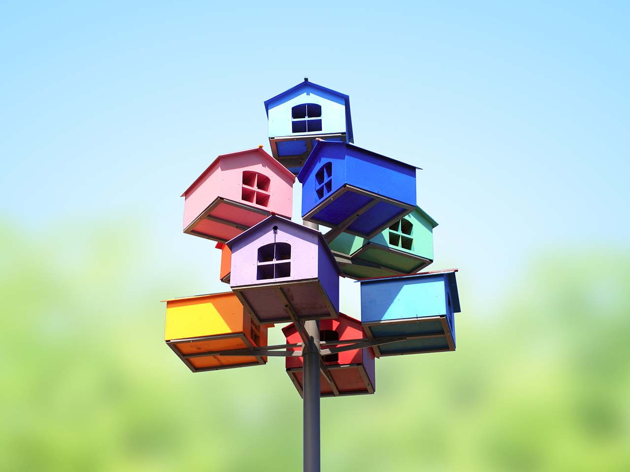 Colourful model houses as nesting boxes