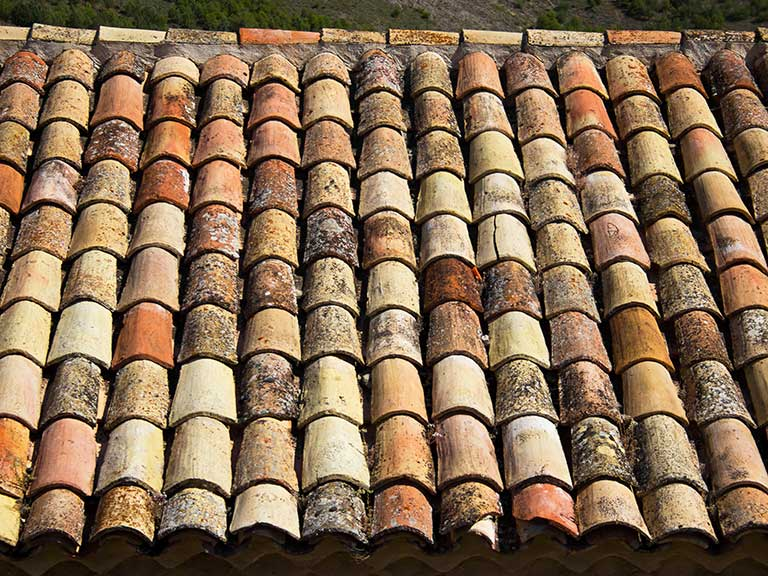 Crumbling clay roof tiles