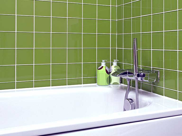 An avocado tiled bathroom
