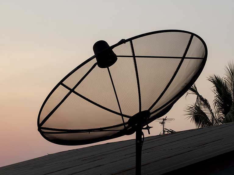 A satellite dish pointing to the sky for better TV reception