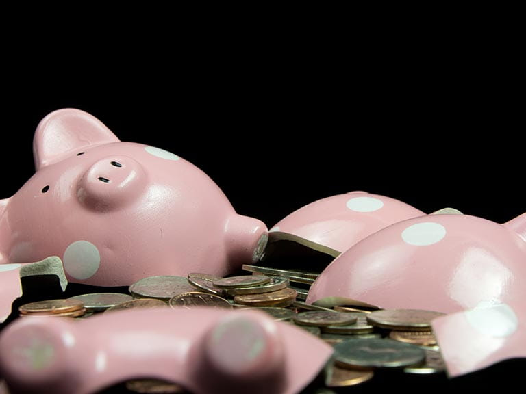 A broken piggybank represents mistakes made when purchasing an annuity