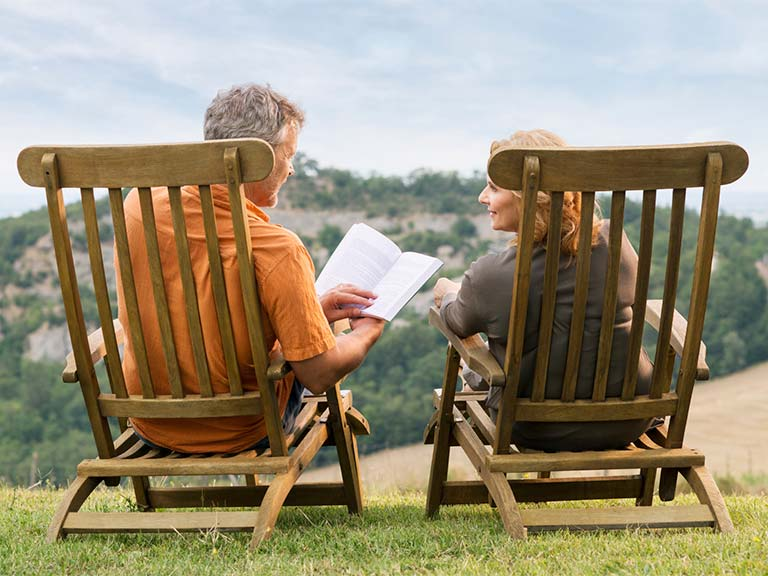 Senior couple in deckchairs outside