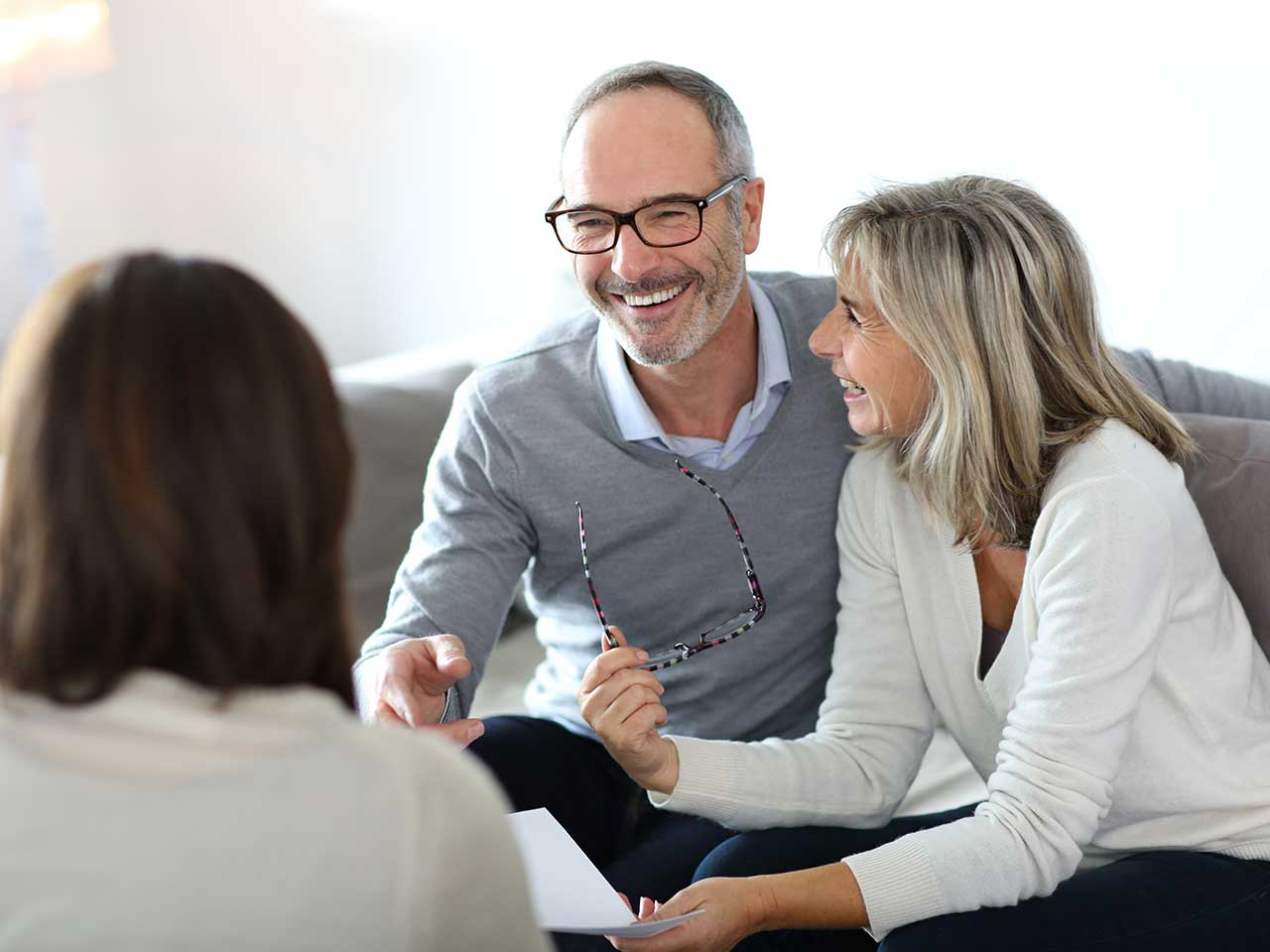 Mature couple talking to financial advisor about pension advice