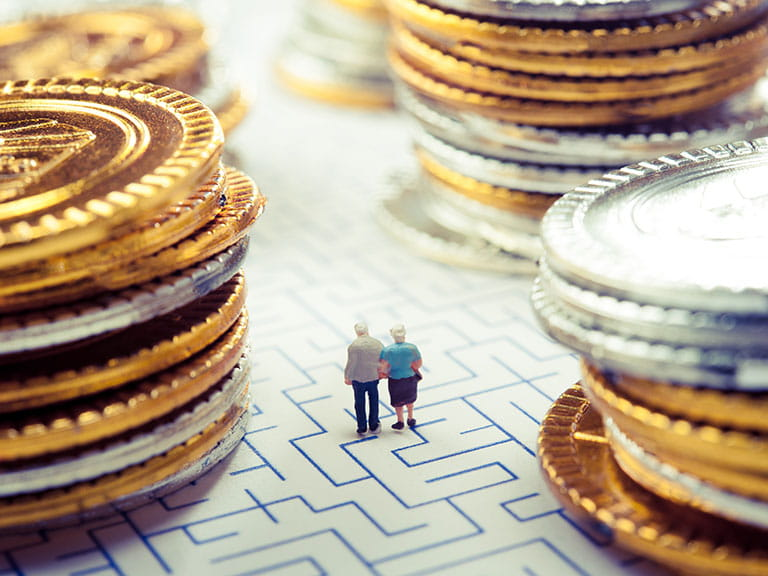 A model of an older couple navigating a maze to represent pensions