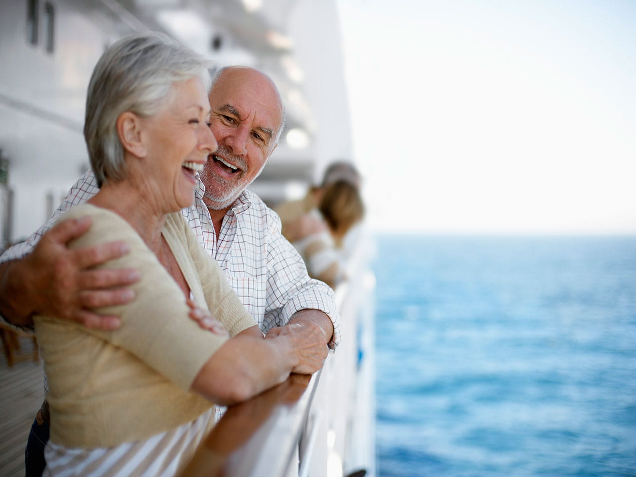 Happy retired couple on a cruise ship