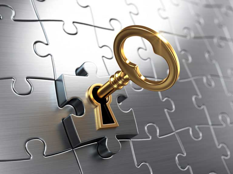 Key unlocking a jigsaw piece to represent unlocking the money in your annuity