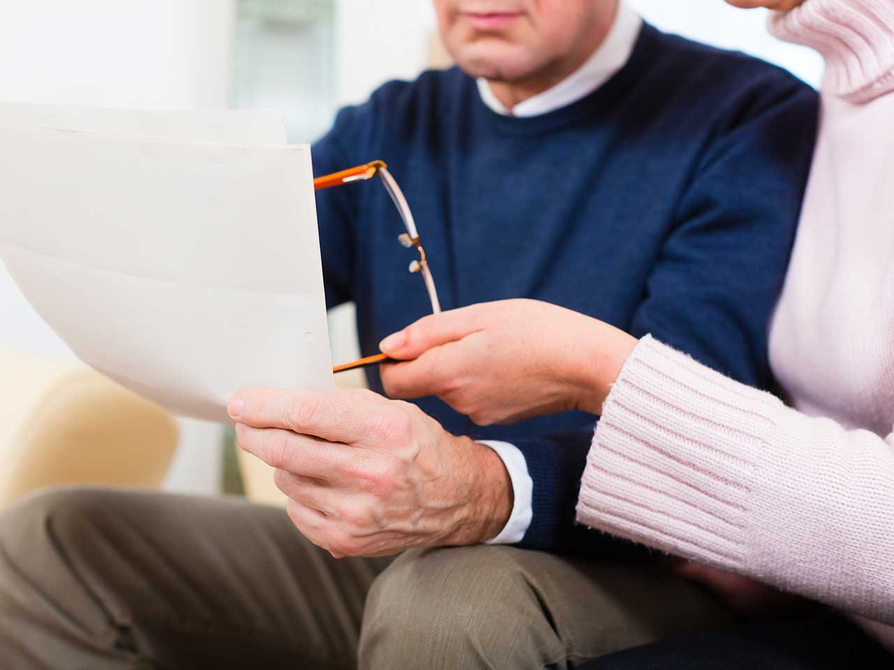 Mature couple looking at paperwork