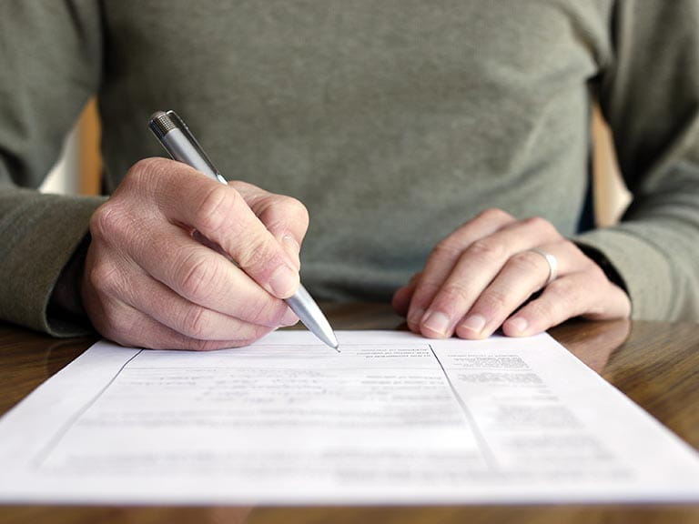 Man filling in form to claim mis-sold PPI