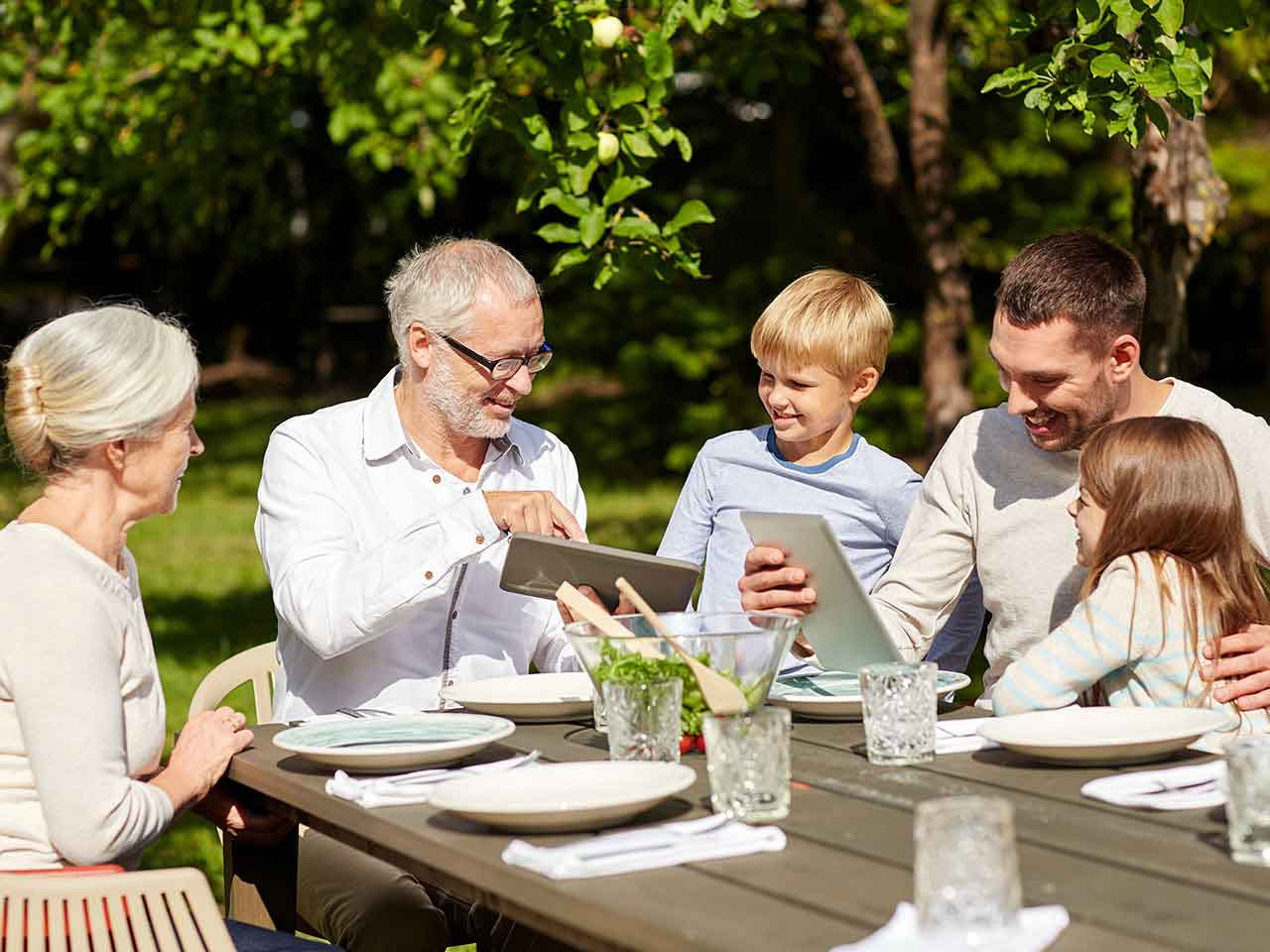 Grandparents and family having lunch outside