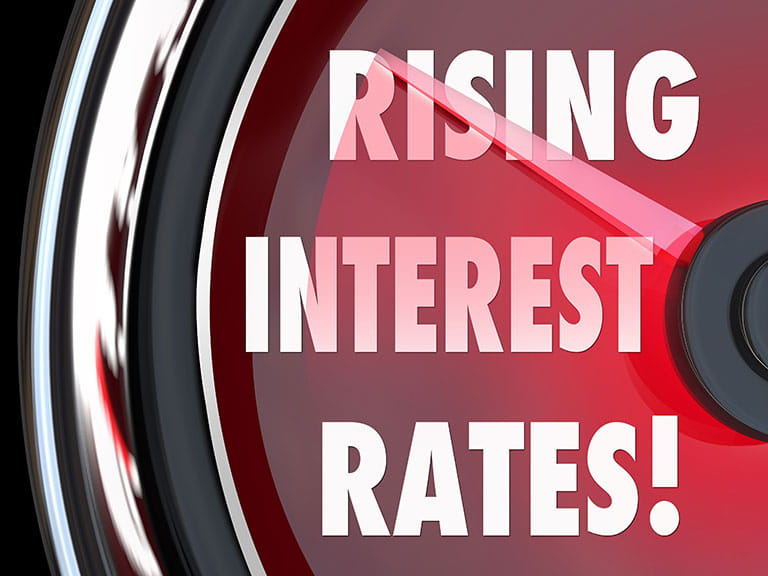 Gauge needle pointing to rising interest rates