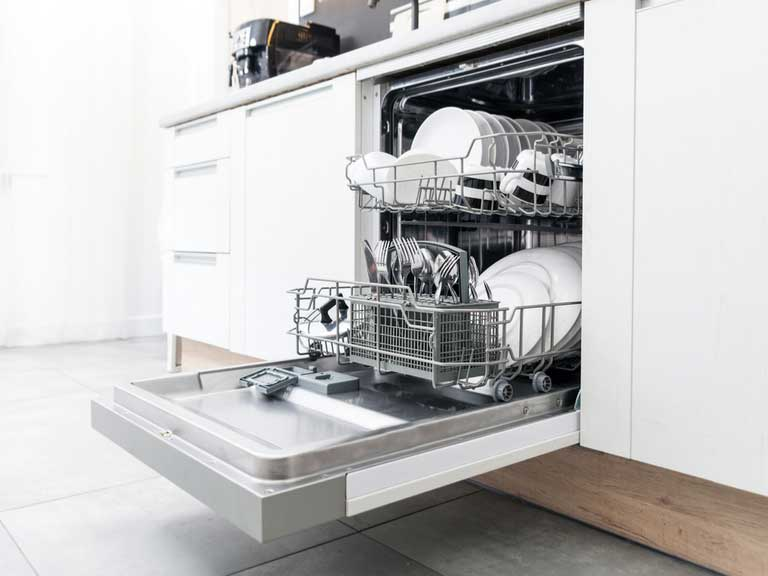 A dishwasher with the drawer open