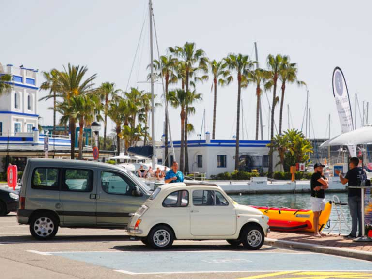 cars parked by a harbour in Spain