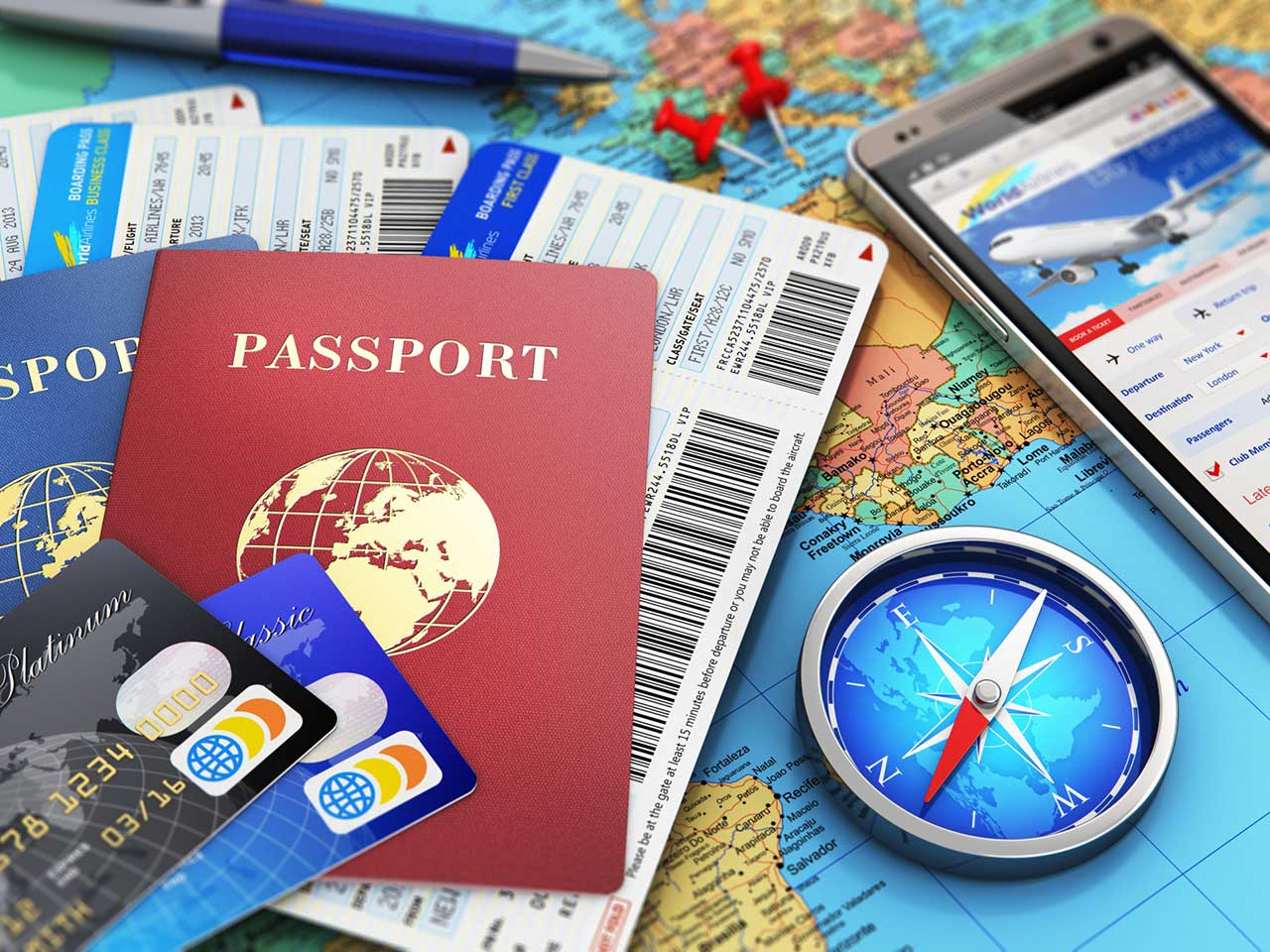 Passports, travel tickets, maps, credit cards and travel apps