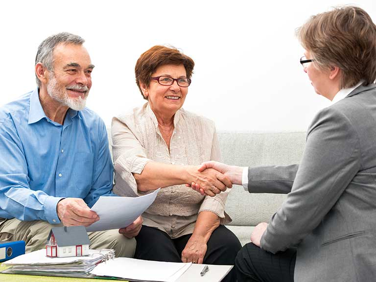 An older couple get advice from a financial advisor