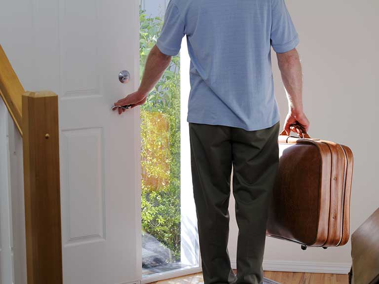 A man leaves his home to go travelling - hopefully he has the correct home insurance in place