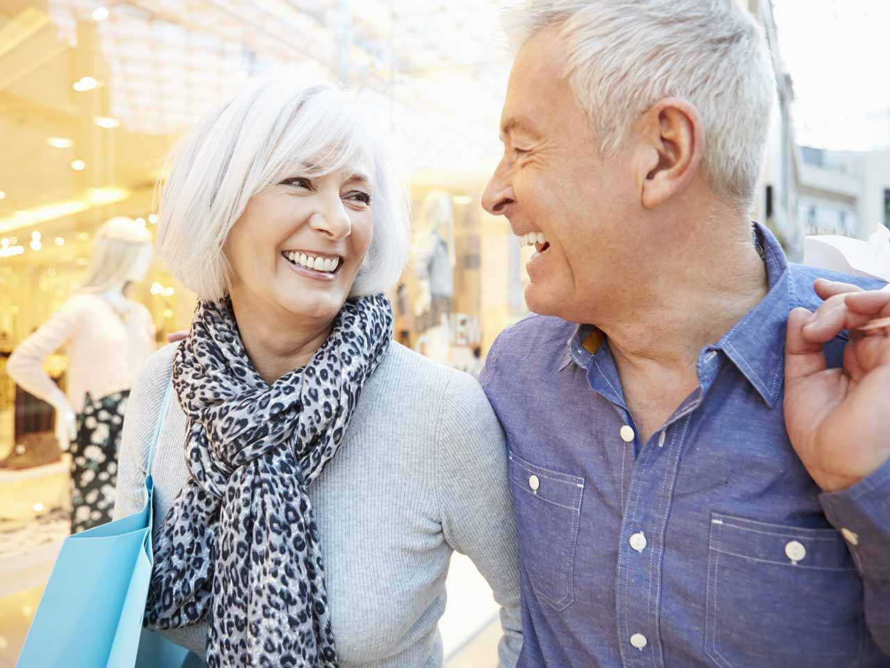 Smiling mature couple shopping