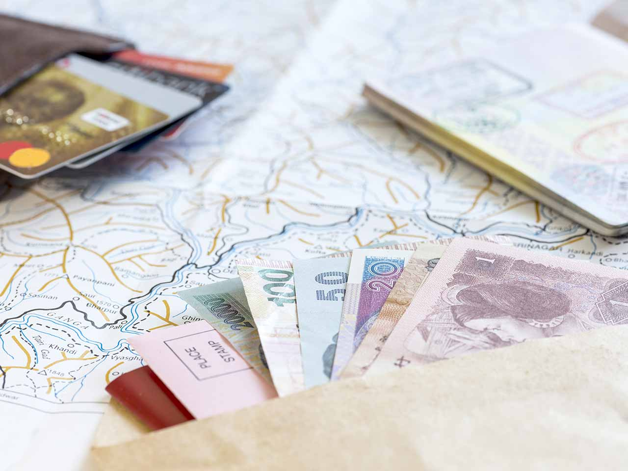 Passport, money and a map
