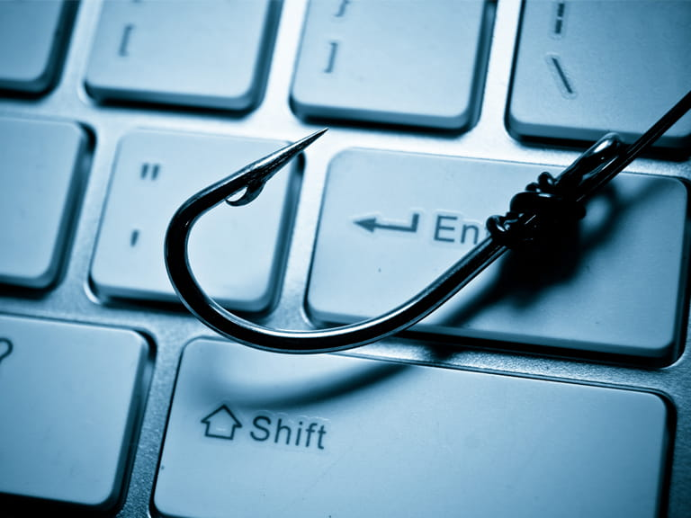 Hook on a keyboard to represent phising scams