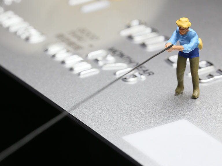 Miniature figure on credit card fishing