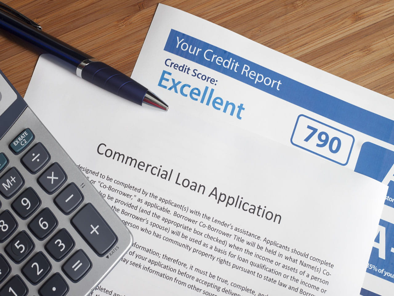 Loan application and a credit report with an excellent score