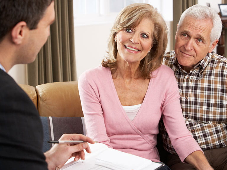 An older couple are pleased to hear that they can get a mortgage
