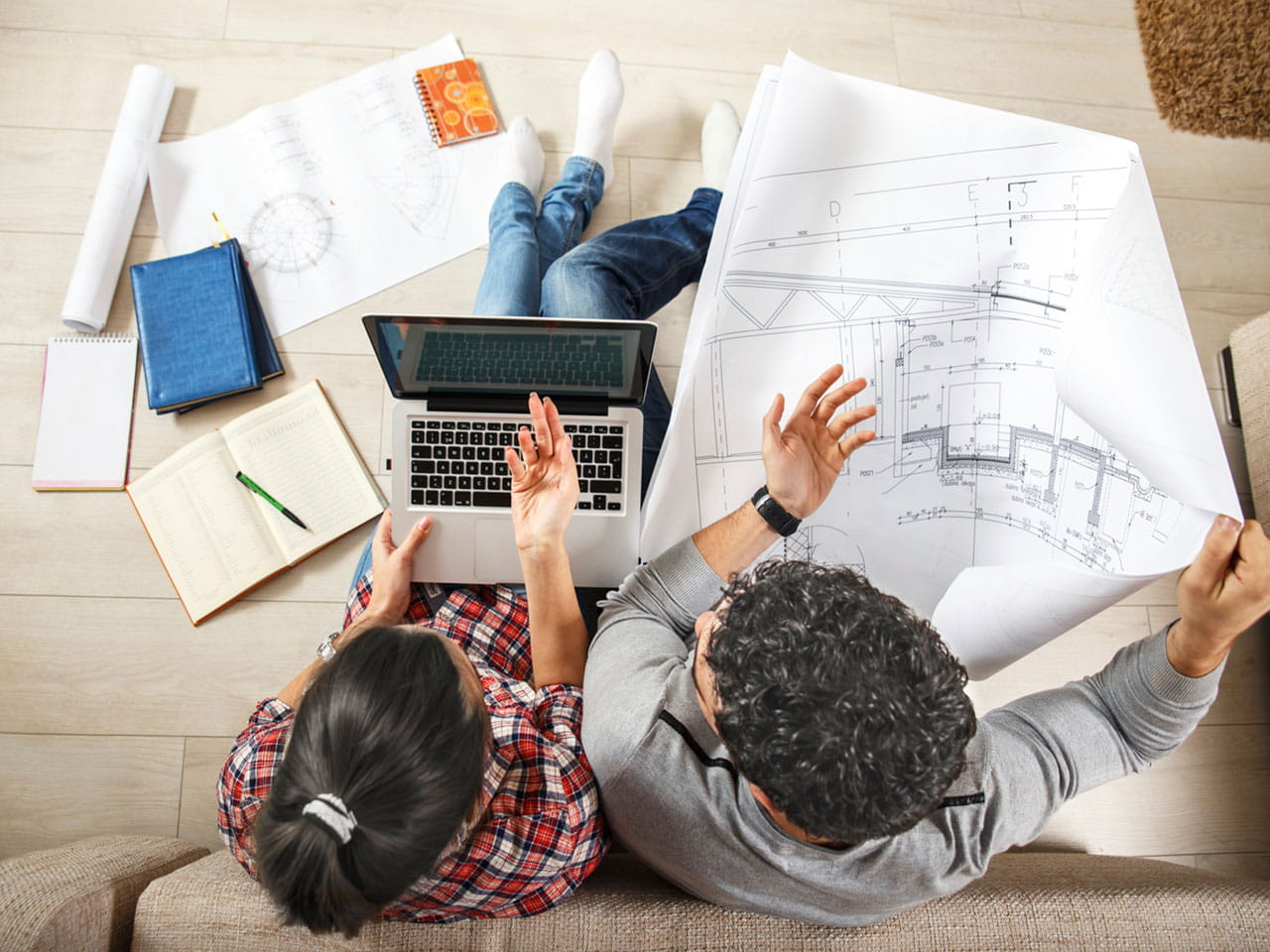 Couple looking at plans before buying a property