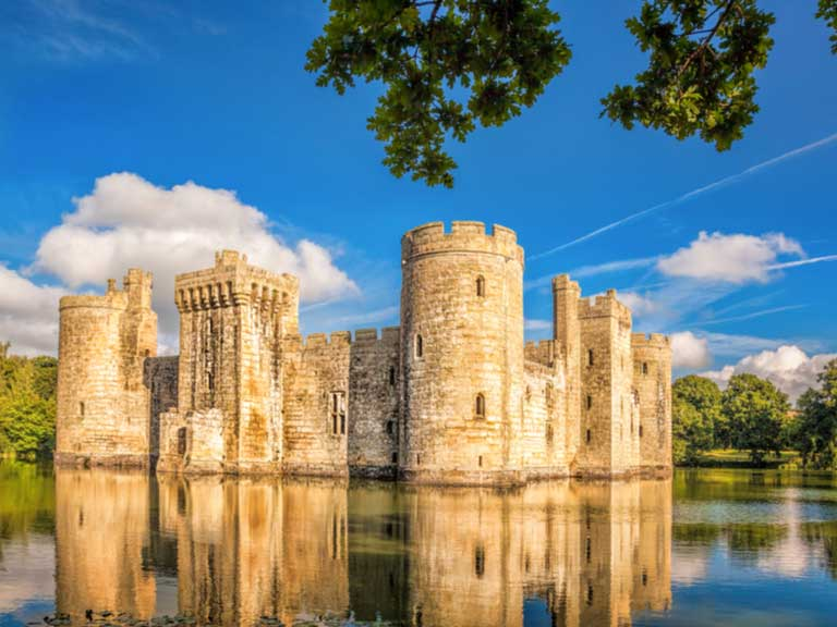 Medieval Bodiam Castle surrounded by a water-filled moat