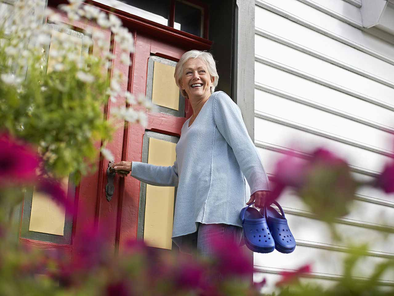 Mature woman entering house