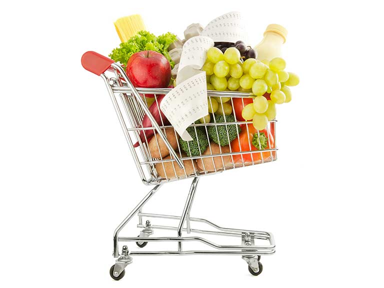A shopping trolley filled with food and a long bill to represent spending on food