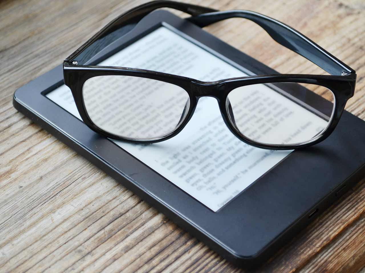 Kindle and a pair of glasses