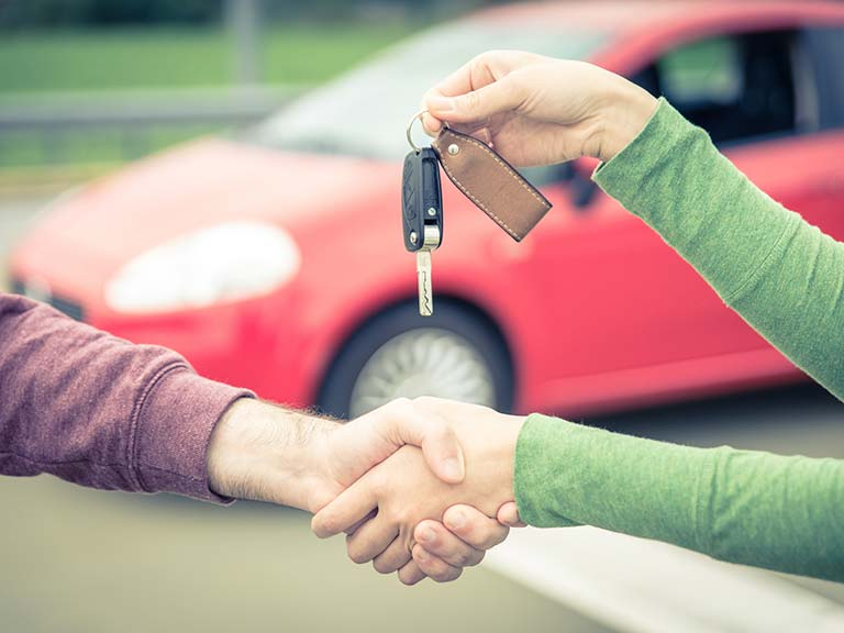 Car seller and buyer agreeing on a sale