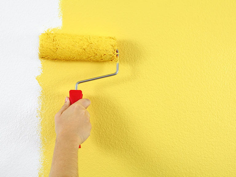 Decorating roller painting wall yellow
