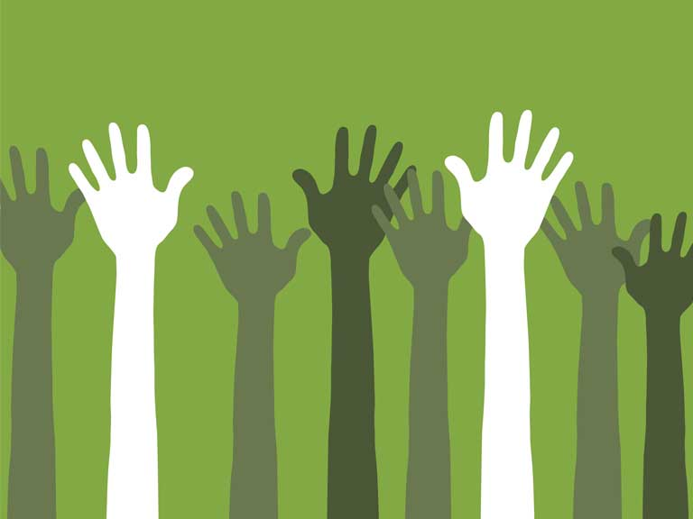 Hands raised to represent community and helping your peers
