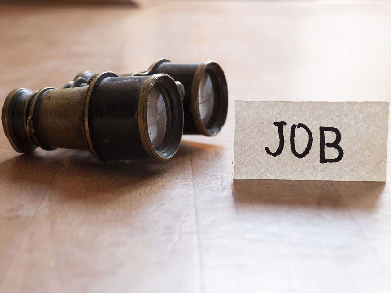 Binoculars and job sign denoting career search