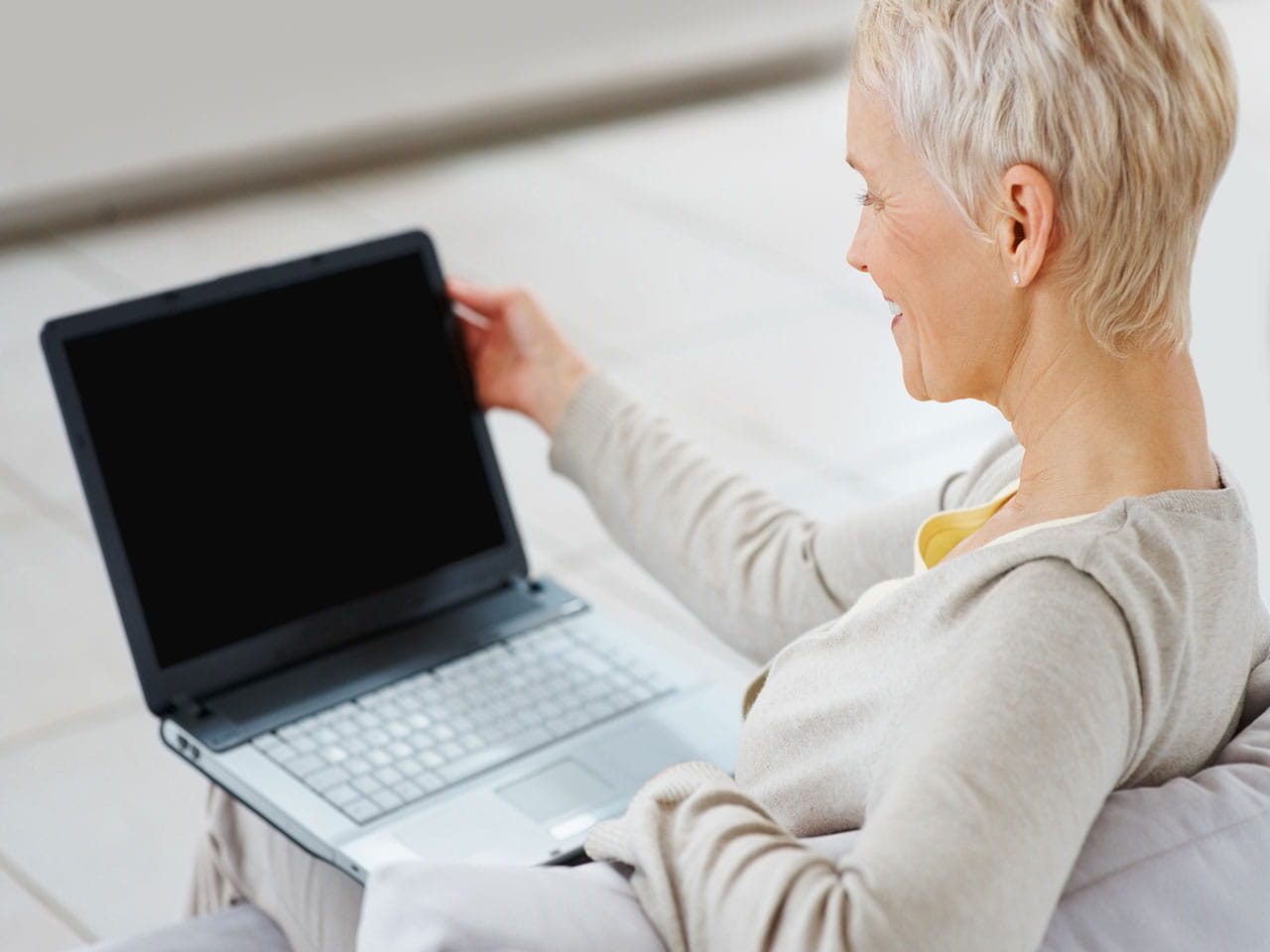 Mature woman at home on a laptop
