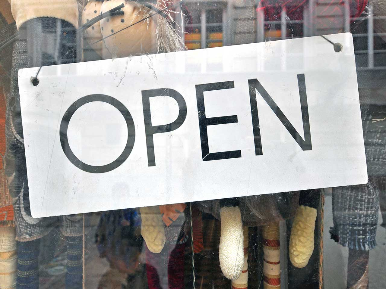 Open sign in a shop woindow