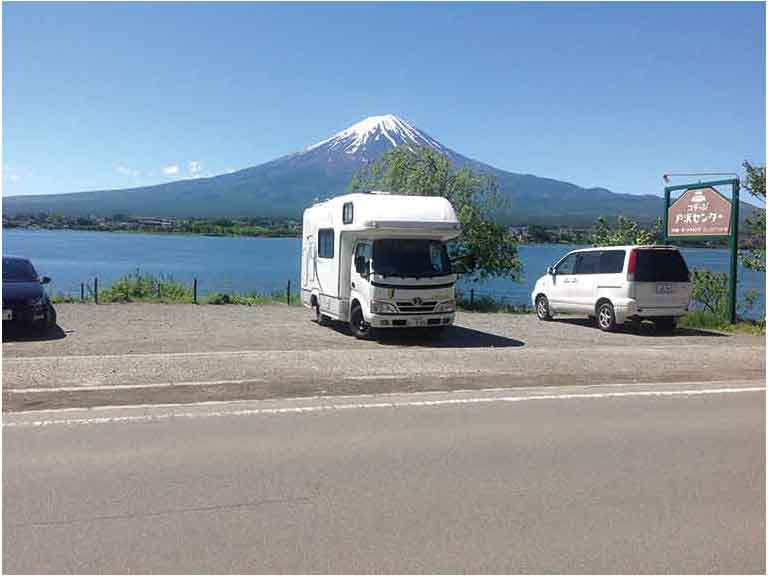 Motorhome parked by lake with view of Mount Fuji, Japan