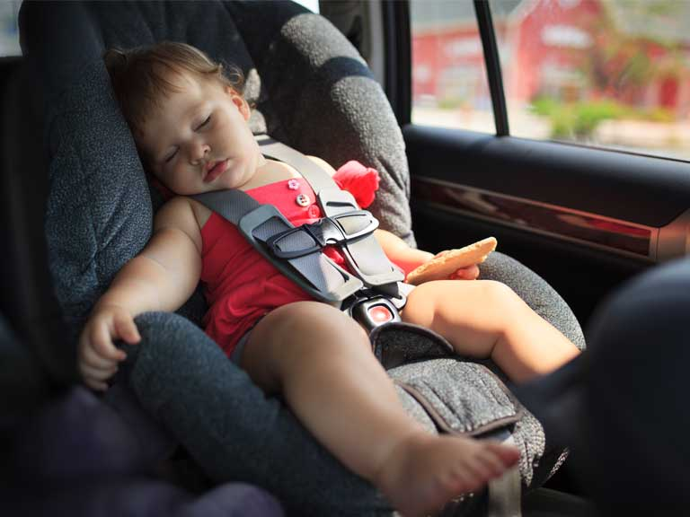 Child of toddler age in a front facing car seat