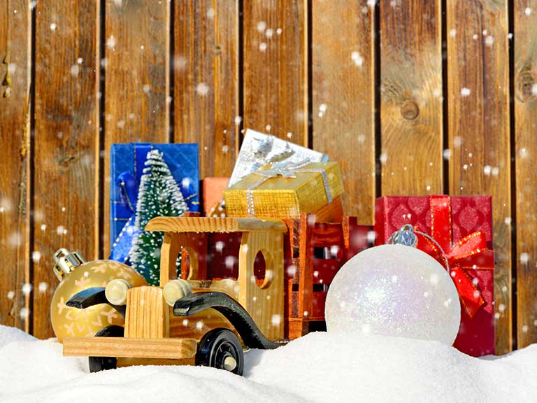 A toy car surrounded by Christmas presents