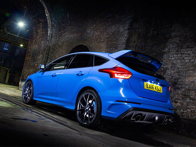 The Focus RS has a huge rear spoiler, a lovely rear diffuser, twin tail pipes, and the largest front air intake the engineers could squeeze in