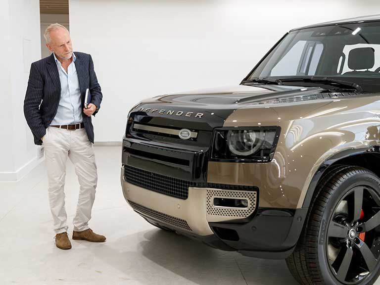 Motoring journalist admires shiny new Land Rover Defender