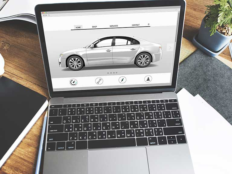 A laptop open on a car buying website