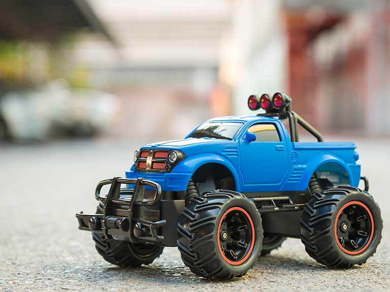A remote control monster truck to represent how cars are getting larger