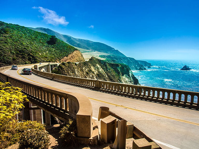 Cars driving down the Big Sur in America