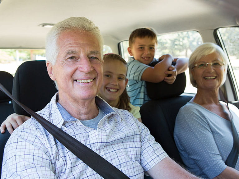 A family of grandparents and grandchildren set out on a road trip