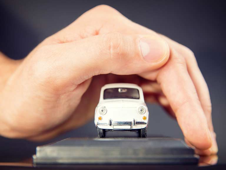 Hand shielding a classic car to protect it
