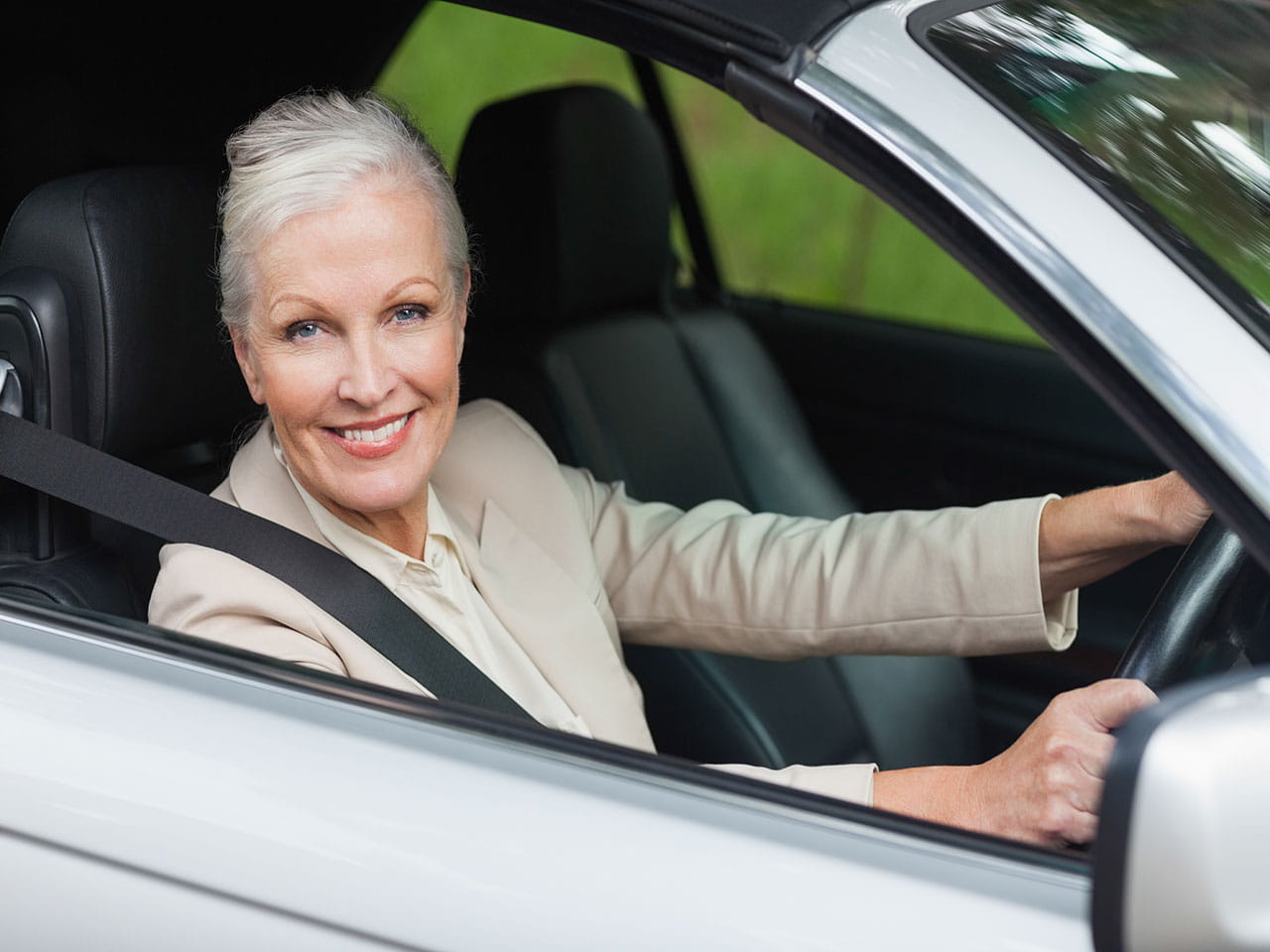 Mature lady driving a car