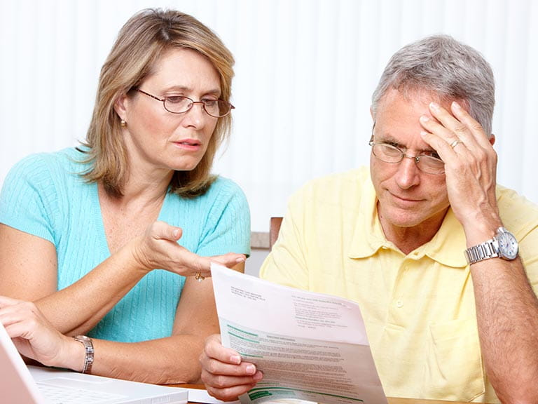 An older couple angry for being caught out by the driving licence scam