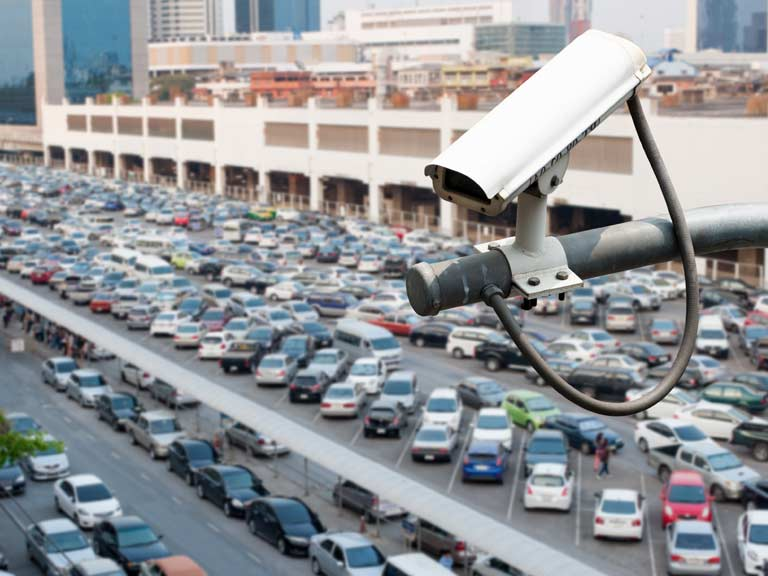 Parked cars being watched by CCTV cameras